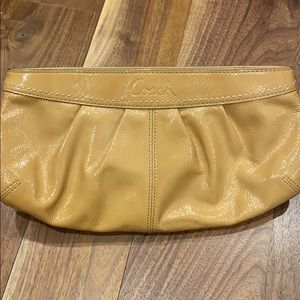 Coach sand patent clutch bag